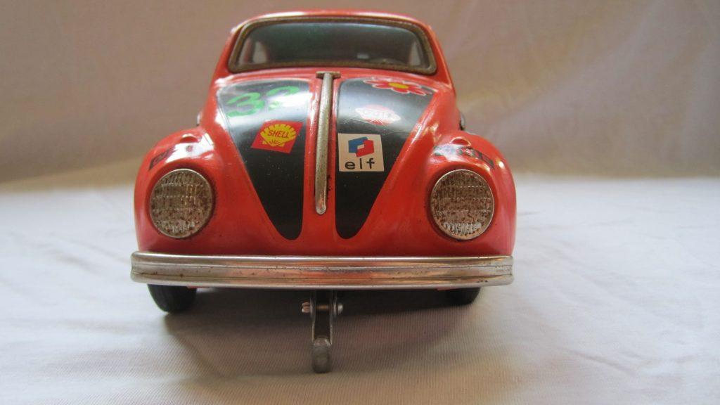 VW Käfer Blechspielzeugauto Orange mit Rallyaufklebern Japan Fa. Taiyo